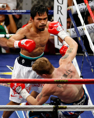 LAS VEGAS - MAY 02:  (L-R) Manny Pacquiao of the Philippines knocks down Ricky Hatton of England during their junior welterweight title fight at the MGM Grand Garden Arena May 2, 2009 in Las Vegas, Nevada.  (Photo by Ethan Miller/Getty Images)