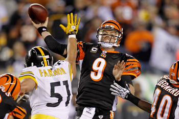 CINCINNATI - NOVEMBER 08:  Carson Palmer #9 of the Cincinnati Bengals throws against the Pittsburgh Steelers at Paul Brown Stadium on November 8, 2010 in Cincinnati, Ohio.  (Photo by Matthew Stockman/Getty Images)