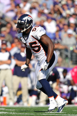 BALTIMORE, MD - OCTOBER 10: D. J. Williams #55 of the Denver Broncos defends against the Baltimore Ravens at M&T Bank Stadium on October 10, 2010 in Baltimore, Maryland. Players wore pink in recognition of Breast Cancer Awareness Month. The Ravens defeate