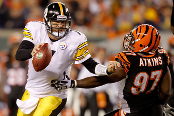 CINCINNATI - NOVEMBER 08:  Quarterback Ben Roethlisberger #7 of the Pittsburgh Steelers breaks free from Geno Atkins #97 of the Cincinnati Bengals at Paul Brown Stadium on November 8, 2010 in Cincinnati, Ohio.  The Steelers defeated the Bengals 27-21. (Ph