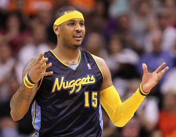 PHOENIX - APRIL 13:  Carmelo Anthony #15 of the Denver Nuggets reacts during the NBA game against the Phoenix Suns at US Airways Center on April 13, 2010 in Phoenix, Arizona. The Suns defeated the Nuggets 123-101.  NOTE TO USER: User expressly acknowledge