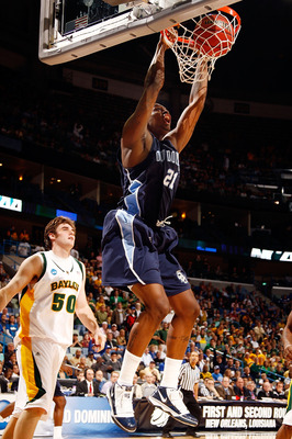 NEW ORLEANS - MARCH 20:  Frank Hassell #21 of the Old Dominion University Monarchs dunks the ball over Josh Lomers #50 of the Baylor Bears during the second round of the 2010 NCAA men's basketball tournament at the New Orleans Arena on March 20, 2010 in N