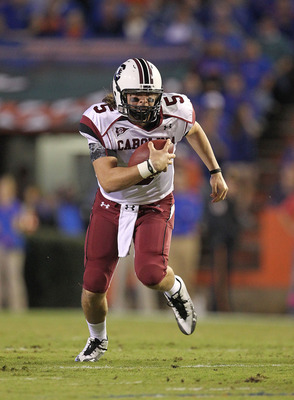 GAINESVILLE, FL - NOVEMBER 13:  Stephen Garcia #5 of the South Carolina Gamecocks rushes during a game against the Florida Gators at Ben Hill Griffin Stadium on November 13, 2010 in Gainesville, Florida.  (Photo by Mike Ehrmann/Getty Images)