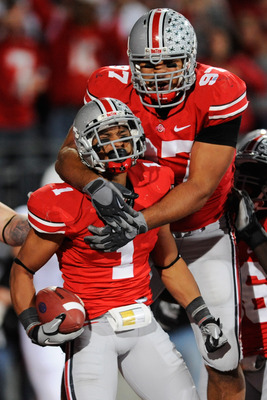 COLUMBUS, OH - NOVEMBER 13:  Cameron Heyward #97 of the Ohio State Buckeyes celebrates with Devon Torrence #1 of the Ohio State Buckeyes after Torrence returned an interception 34-yards for a touchdown against the Penn State Nittany Lions at Ohio Stadium