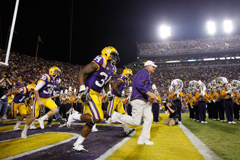 BATON ROUGE, LA - NOVEMBER 13:  Head coach Les Miles of the Louisiana State University Tigers runs onto the field before playing the University of Louisiana-Monroe Warhawks at Tiger Stadium on November 13, 2010 in Baton Rouge, Louisiana.   The Tigers defe