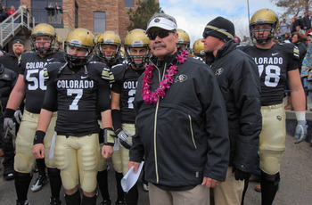 BOULDER, CO - NOVEMBER 13:  Interim head coach Brian Cabral prepares to lead Cody Hawkins #7 and the Colorado Buffaloes onto the field to face the Iowa State Cyclones at Folsom Field on November 13, 2010 in Boulder, Colorado. Cabral made his debut as inte
