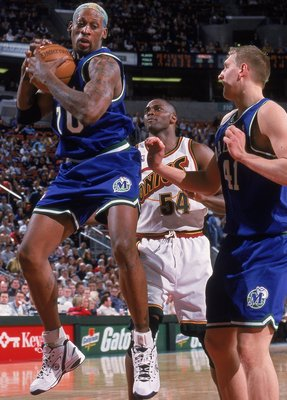 7 Mar 2000: Dennis Rodman #70 of the Dallas Mavericks rebounds the ball during a game against the Seattle SuperSonics at the Key Arena in Seattle, Washington. The Sonics defeated the Mavericks 101-86.
