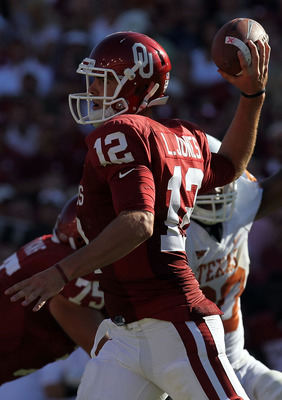 DALLAS - OCTOBER 02:  Quarterback Landry Jones #12 of the Oklahoma Sooners drops back to pass against the Texas Longhorns in the fourth quarter at the Cotton Bowl on October 2, 2010 in Dallas, Texas.  (Photo by Ronald Martinez/Getty Images)