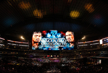 ARLINGTON, TX - NOVEMBER 13:  The giant video screen displays the main event title bout match up between Manny Pacquiao (L) of the Philippines and Antonio Margarito of Mexico prior to their WBC World Super Welterweight Title bout at Cowboys Stadium on Nov