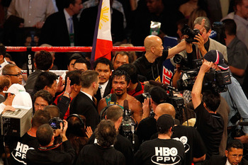 ARLINGTON, TX - NOVEMBER 13:  Manny Pacquiao (white trunks) of the Philippines is interviewed after he won against Antonio Margarito (black trunks) of Mexico during their WBC World Super Welterweight Title bout at Cowboys Stadium on November 13, 2010 in A