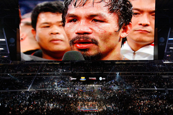ARLINGTON, TX - NOVEMBER 13:  THe likeness of Manny Pacquiao (white trunks) of the Philippines is seen on the giant screen as he is interviewed after he won against Antonio Margarito (black trunks) of Mexico during their WBC World Super Welterweight Title