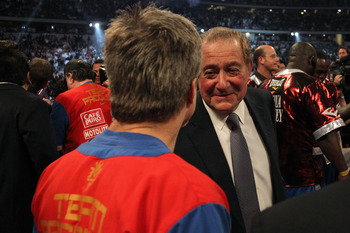 ARLINGTON, TX - MARCH 13:  (R-L) Promoter Bob Arum talks with trainer Freddie Roach, who trains Manny Pacquiao of the Philippines, in the ring after Pacquiao defeated Joshua Clottey of Ghana during the WBO welterweight title fight at Cowboys Stadium on Ma
