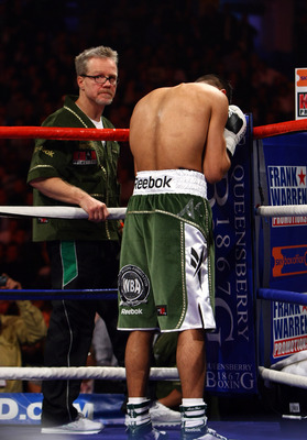 NEWCASTLE UPON TYNE, ENGLAND - DECEMBER 05:  Amir Khan says a prayer watched by his trainer Freddie Roach (L) before his fight against Dmitriy Salita of the U.S. for the WBA Light Welterweight title on December 5, 2009 in Newcastle upon Tyne, England.  (P