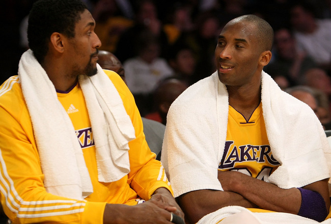 LOS ANGELES, CA - JANUARY 15:  (L-R) Ron Artest #37 and Kobe Bryant #24 of the Los Angeles Lakers talk on the bench during the game against the Los Angeles Clippers on January 15, 2010 at Staples Center in Los Angeles, California. The Lakers won 126-86.