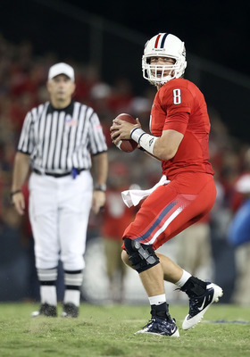 TUCSON, AZ - SEPTEMBER 25:  Quarterback Nick Foles #8 of the Arizona Wildcats drops back to pass during the college football game against the California Golden Bears at Arizona Stadium on September 25, 2010 in Tucson, Arizona.   The Wildcats defeated the