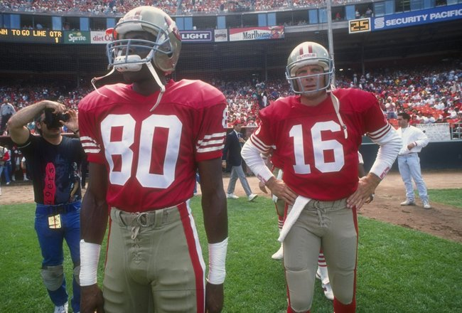 23 Sep 1990:  San Francisco 49ers wide receiver Jerry Rice (left) and quarterback Joe Montana look on during a game against the Atlanta Falcons at Candlestick Park in San Francisco, California.  The 49ers won the game, 19-13. Mandatory Credit: Otto Greule