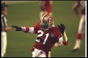 29 Jan 1995:  Defensive back Deion Sanders of the San Francisco 49ers celebrates during Super Bowl XXIX against the San Diego Chargers at Joe Robbie Stadium in Miami, Florida.  The 49ers won the game, 49-26. Mandatory Credit: Doug Pensinger  /Allsport
