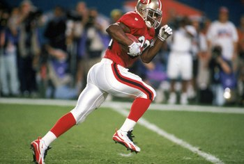 MIAMI - JANUARY 29:  Running back Ricky Watters #32 of the San Francisco 49ers runs for a touchdown during Super Bowl XXIX against the San Diego Chargers at Joe Robbie Stadium on January 29, 1995 in Miami, Florida. The 49ers won 49-26. (Photo by George Ro