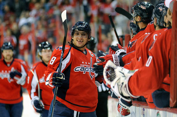 WASHINGTON - NOVEMBER 14:  Alex Ovechkin #8 of the Washington Capitals celebrates with teammates after scoring in the first period against the Atlanta Thrashers at the Verizon Center on November 14, 2010 in Washington, DC.  (Photo by Greg Fiume/Getty Imag