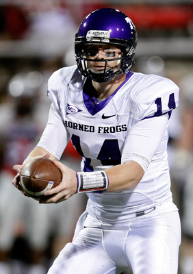 LAS VEGAS - OCTOBER 30:  Quarterback Andy Dalton #14 of the Texas Christian University Horned Frogs looks to hand the ball off during a game against the UNLV Rebels at Sam Boyd Stadium October 30, 2010 in Las Vegas, Nevada. TCU won 48-6.  (Photo by Ethan