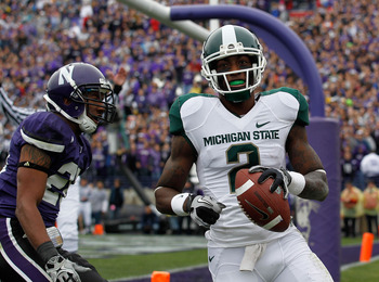 EVANSTON, IL - OCTOBER 23: Mark Dell #2 of the Michigan State Spartans scores a touchdown in front of Justan Vaughn #28 of the Northwestern Wildcats at Ryan Field on October 23, 2010 in Evanston, Illinois. Michigan State defeated Northwestern 35-27. (Phot