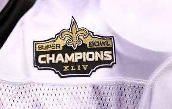 NEW ORLEANS - SEPTEMBER 09: A detail of the New Orleans Saints Super Bowl Champions patch is seen on the jersey of Drew Brees at Louisiana Superdome on September 9, 2010 in New Orleans, Louisiana.  (Photo by Ronald Martinez/Getty Images)
