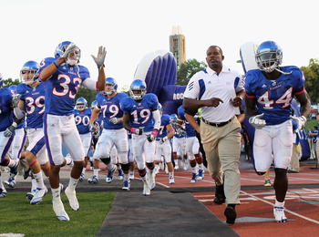 LAWRENCE, KS - OCTOBER 14:  Head coach Turner Gill of the Kansas Jayhawks trots onto the field ahead of the game against the Kansas State Wildcats on October 14, 2010 at Memorial Stadium in Lawrence, Kansas.  (Photo by Jamie Squire/Getty Images)