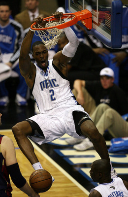 ORLANDO, FL - MAY 30: Dwight Howard #12 of the Orlando Magic dunks the ball against the Cleveland Cavaliers in Game Six of the Eastern Conference Finals during the 2009 Playoffs at Amway Arena on May 30, 2009 in Orlando, Florida. NOTE TO USER: User expres