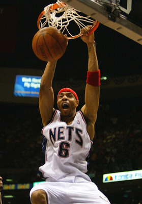 EAST RUTHERFORD, NJ - APRIL 20:  Kenyon Martin #6 of the New Jersey Nets dunks against the New York Knicks during game 2 of their first round 2004 NBA Eastern Conference playoff game on April 20, 2004 at the Continental Airlines Arena  in East Rutherford,