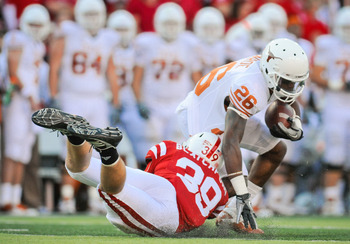 LINCOLN, NE - OCTOBER 16: Running back D.J. Monroe #26 of the Texas Longhorns gets brought down my defensive back Justin Blatchford #39 of the Nebraska Cornhuskers during their game at Memorial Stadium on October 16, 2010 in Lincoln, Nebraska. Texas Defea