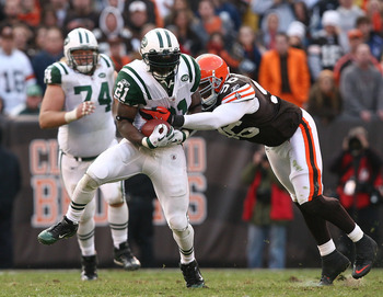 CLEVELAND - NOVEMBER 14:  Running back LaDainian Tomlinson #21 of the New York Jets runs the ball by linebacker David Bowens #96 of the Cleveland Browns  at Cleveland Browns Stadium on November 14, 2010 in Cleveland, Ohio.  (Photo by Matt Sullivan/Getty I