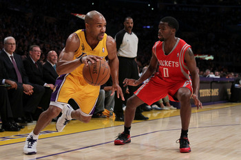 LOS ANGELES, CA - OCTOBER 26:  Derek Fisher #2 of the Los Angeles Lakers dribbles the ball against Aaron Brooks #0 of the Houston Rockets during their opening night game at Staples Center on October 26, 2010 in Los Angeles, California. NOTE TO USER: User