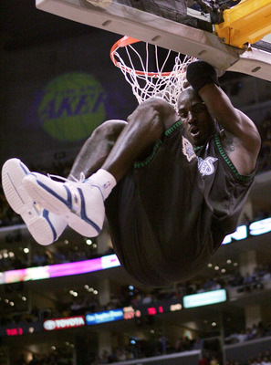 LOS ANGELES - MAY 27:  Kevin Garnett #21 of the Minnesota Timberwolves hangs on the rim following a dunk against the Los Angeles Lakers in the first half of Game 4 of the Western Conference Finals during the 2004 NBA Playoffs on May 27, 2004 at Staples Ce