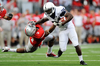 COLUMBUS, OH - NOVEMBER 13:  Silas Redd #25 of the Penn State Nittany Lions stiff arms Jermale Hines #7 of the Ohio State Buckeyes at Ohio Stadium on November 13, 2010 in Columbus, Ohio.  (Photo by Jamie Sabau/Getty Images)