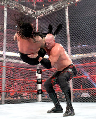 Kane chokeslams the Undertaker, photo copyright to WWE.com