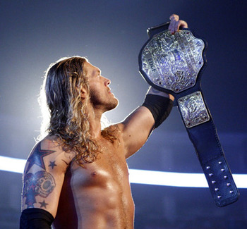 Edge with the World Heavyweight Championship, photo copyright to WWE.com