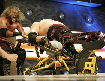 Edge defeating Kane in a stretcher match, photo copyright to WWE.com