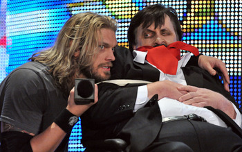 "Edge holding Paul Bearer ""hostage,"" photo copyright to WWE.com"