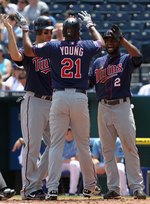 KANSAS CITY, MO - JULY 28:  Delmon Young #21 of the Minnesota Twins is congratulated by Joe Mauer #7 and Denard Span #2 after hitting a 3-run home run during the 1st inning of the game against the Kansas City Royals on July 28, 2010 at Kauffman Stadium in