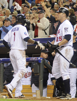 MINNEAPOLIS, MN - OCTOBER 6: Orlando Hudson #1 of the Minnesota Twins celebrates scoring on a passed ball in third inning with Jim Thome #25 during game one of the ALDS against the New York Yankees on October 6, 2010 at Target Field in Minneapolis, Minnes