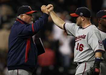 CHICAGO - SEPTEMBER 14: Manager Ron Gardenhire #35 of the Minnesota Twins congratulates Jason Kubel #16 after a win over the Chicago White Sox at U.S. Cellular Field on September 14, 2010 in Chicago, Illinois. The Twins defeated the White Sox 9-3. (Photo