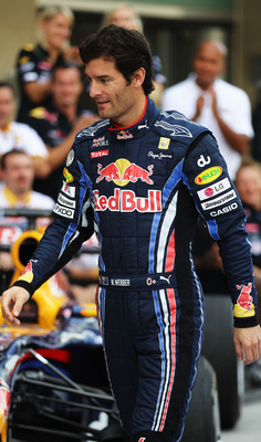ABU DHABI, UNITED ARAB EMIRATES - NOVEMBER 14:  Mark Webber of Australia and Red Bull Racing arrives for his team end of season team photograph before the Abu Dhabi Formula One Grand Prix at the Yas Marina Circuit on November 14, 2010 in Abu Dhabi, United