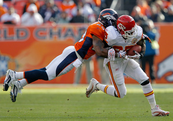 DENVER - NOVEMBER 14:  Safety Brian Dawkins #20 of the Denver Broncos makes a diving attempt to tackle running back Jamaal Charles #25 of the Kansas City Chiefs during the first quarter at INVESCO Field at Mile High on November 14, 2010 in Denver, Colorad