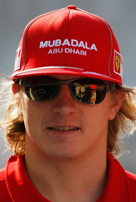 ABU DHABI, UNITED ARAB EMIRATES - NOVEMBER 01:  Kimi Raikkonen of Finland and Ferrari attends the drivers parade before the Abu Dhabi Formula One Grand Prix at the Yas Marina Circuit on November 1, 2009 in Abu Dhabi, United Arab Emirates.  (Photo by Mark