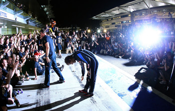 ABU DHABI, UNITED ARAB EMIRATES - NOVEMBER 14:  Sebastian Vettel of Germany and Red Bull Racing gives a bow to his team after the Abu Dhabi Formula One Grand Prix at the Yas Marina Circuit on November 14, 2010 in Abu Dhabi, United Arab Emirates.  (Photo b