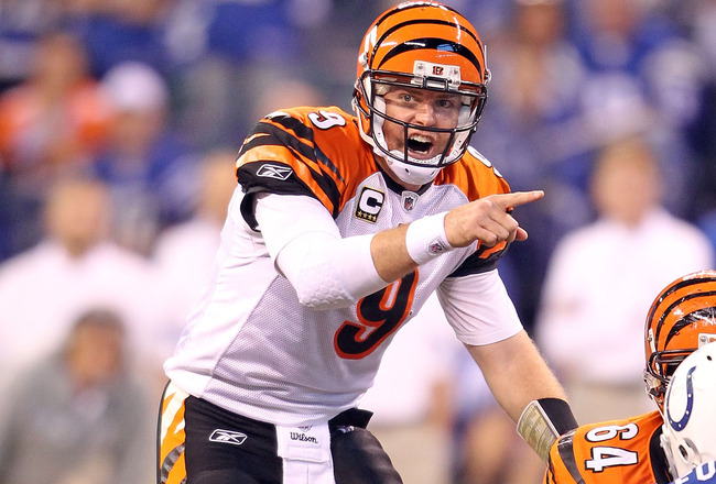 INDIANAPOLIS - NOVEMBER 14:  Carson Palmer #9 of the Cincinnati Bengals gives instructions to his team during the Bengals 23-17 loss to the Indianapolis Colts in the NFL game at Lucas Oil Stadium on November 14, 2010 in Indianapolis, Indiana. (Photo by An