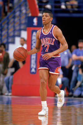 PHOENIX - 1989:  Kevin Johnson #7 of the Phoenix Suns dribbles up court during a 1989 season NBA game at Veteran's Memorial Coliseum in Phoenix, Arizona.  (Photo by Otto Greule Jr/Getty Images)