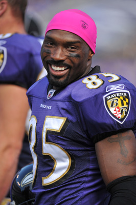 BALTIMORE, MD - OCTOBER 10: Derrick Mason #85 of the Baltimore Ravens smiles on the sideline during the game against the Denver Broncos at M&T Bank Stadium on October 10, 2010 in Baltimore, Maryland. Players wore pink in recognition of Breast Cancer Aware