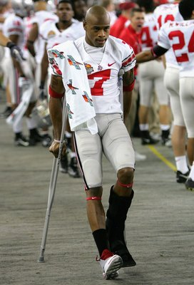 GLENDALE, AZ - JANUARY 08:  Ted Ginn Jr. #7 of the Ohio State Buckeyes walks on the sidelines in crutches after being injured in the first quarter of the 2007 Tostitos BCS National Championship Game against the Florida Gators at the University of Phoenix