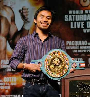 LAS VEGAS - NOVEMBER 11:  Boxer Manny Pacquiao (L) and WBO welterweight champion Miguel Cotto pose during the final news conference for their bout at the MGM Grand Hotel/Casino November 11, 2009 in Las Vegas, Nevada. Pacquiao and Cotto will meet in a WBO